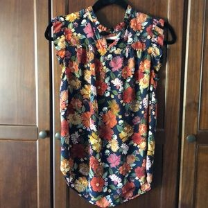Blouse with ruffle detail at neckline and sleeves.